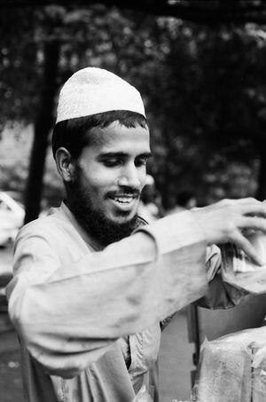 Street vendor smiling