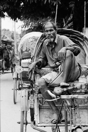 Rickshaw wallah waiting for customers
