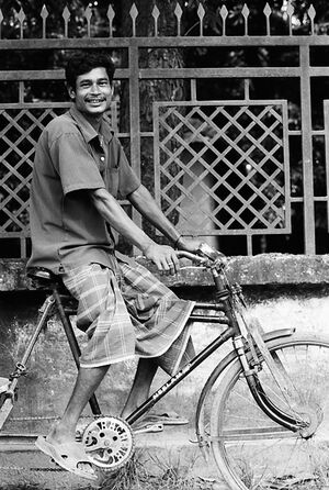 Man smiling on bicycle