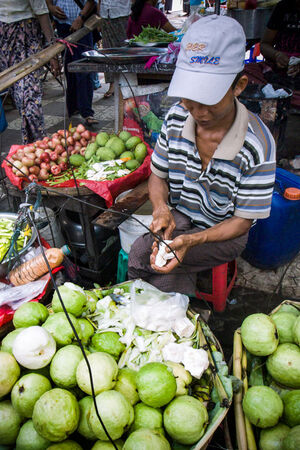 Street vendor selling guava