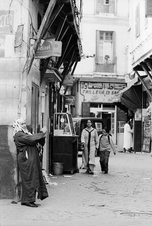 Woman in street corner