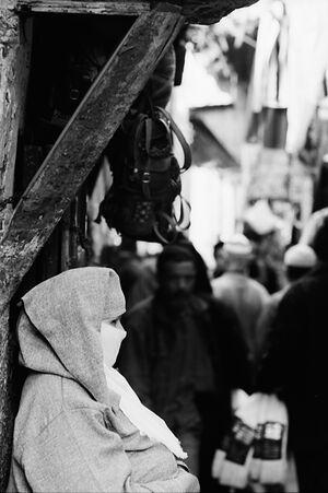 Woman standing in street corner