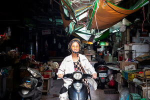 Older woman on motorbike