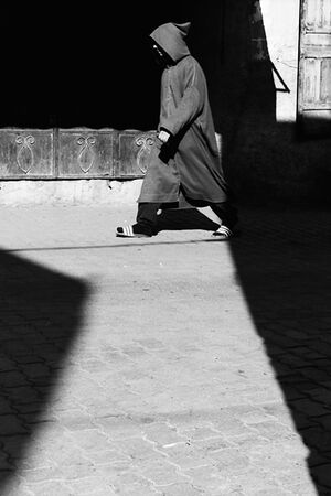 Man wearing jellaba walking
