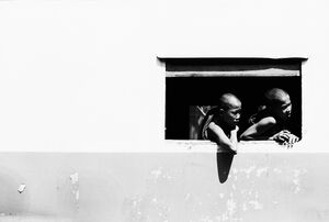 Monks leaning out from window