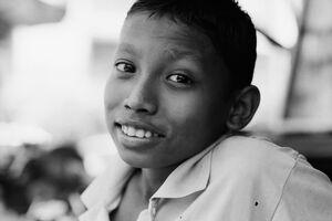 Boy smiling bashfully