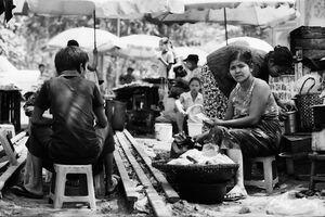 Woman sitting among stalls