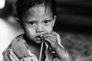 Boy holding straw in mouth