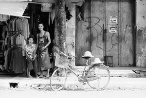 Man, woman and bicycle