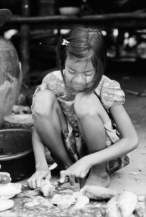 Girl cutting fish