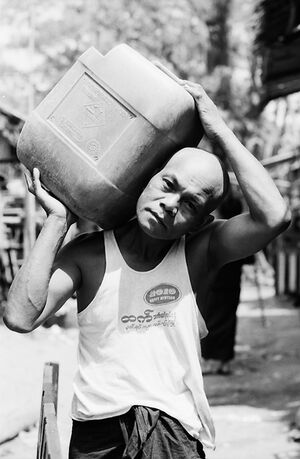 Man carrying container