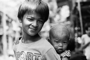 Boy looking after little brother