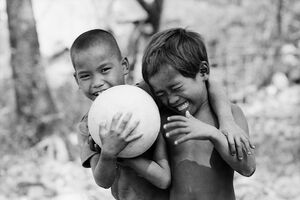 Two boys and one football