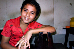 Boy relaxing in restaurant