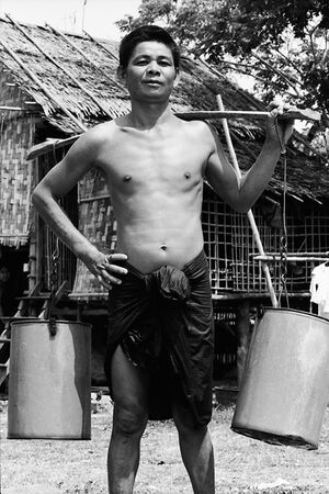 Man carrying on pole