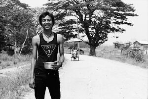 Man holding cigarette and basin
