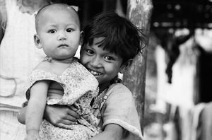 Girl embracing baby
