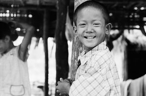 Boy pressing against pillar