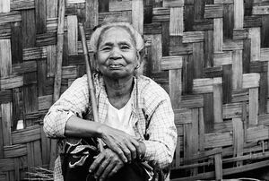 Older woman holding stick