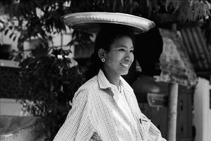 Woman walking with tray on head