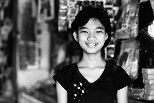 Girl smiling bashfully