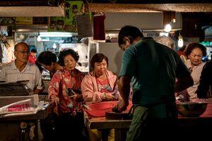 Customers in butcher