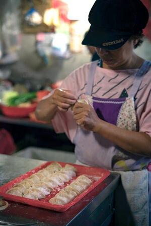 Woman making dumplings