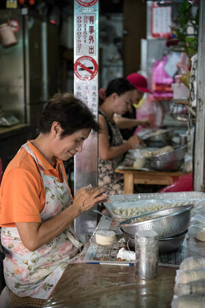 Some women making dumplings