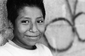 Boy cracking smile