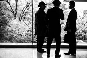 Three men by window