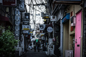 Many signboards in lane called Golden Gai