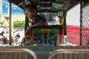 Tuk-tuk driver with rough look