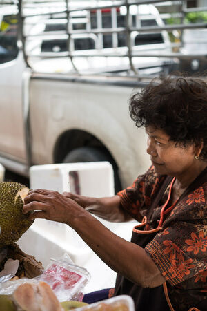 Woman cutting jackfruit