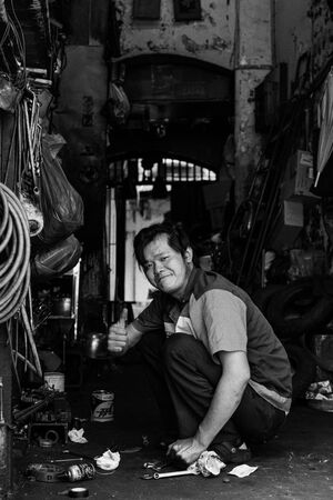 Thumbs-up in maintenance shop