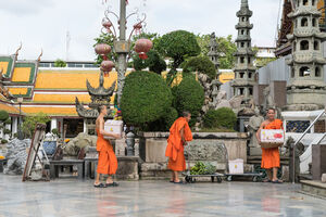 Monks carrying offerings