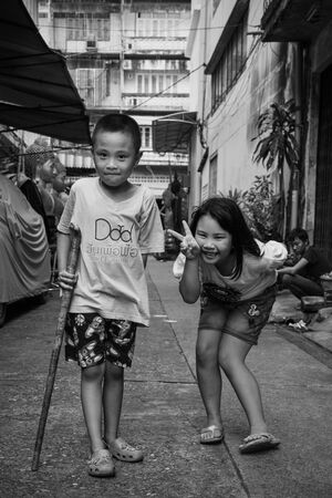 Two kids playing in lane