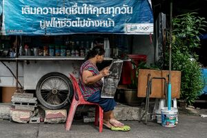Women reading newspaper