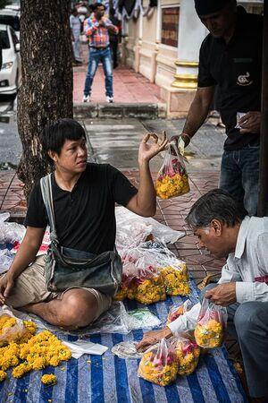Man selling floral offerings