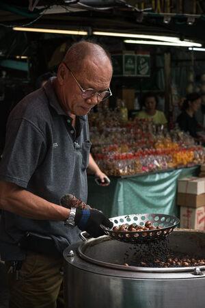 Man roasting chestnuts