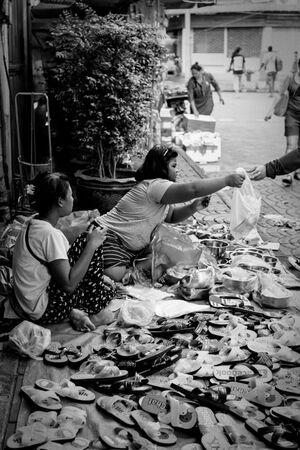 Women selling sandals