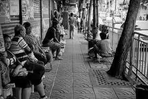People relaxing on sidewalk