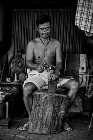 Man making alms bowl