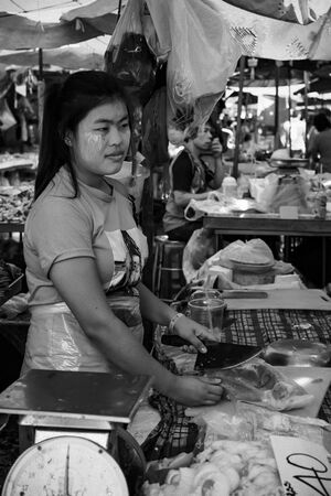 Woman working in butcher in Khlong Toei Market