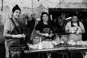 Women cutting chickens