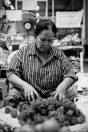Woman selling rambutan