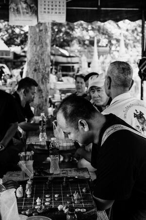 Men playing Thai chess