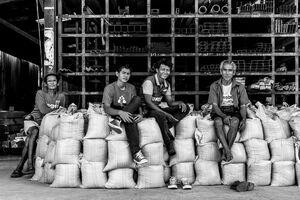 Men sitting on sacks