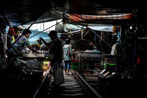 Woman buying in Mae Klong Railway Market