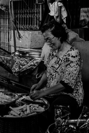 Woman cutting bamboo sprouts
