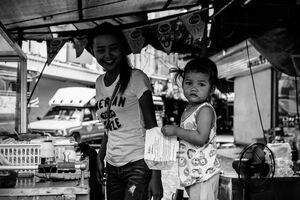 Little girl playing in food stall